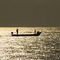 Boat Silhouette In Sunrise At Marina Beach, Chennai by Vasanth Kumar