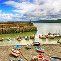 Boats In The Harbor At Clovelly In Devon by Chris Smith
