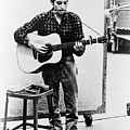Bob Dylan B. 1941 Playing Guitar by Everett