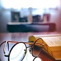 Book And Glasses by Carlos Caetano