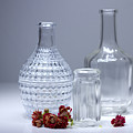 Bottles And Red Flowers  by Lali Nisi