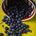 Bowl Pouring Out Blueberries by Garry Gay