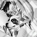 Boy And Dog Hiding Under Blanket by D. Corson/ClassicStock
