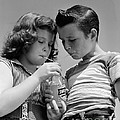 Boy And Girl Sharing A Soda, C.1950s by H. Armstrong Roberts/ClassicStock