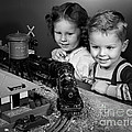 Boy And Girl With Train Set, C.1950s by H. Armstrong Roberts/ClassicStock