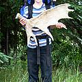 Boy Holding A Moose Antler by Ted Kinsman