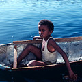Boy In A Tin Boat On The Nile by Carl Purcell