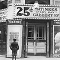 Boy In Front Of A Movie Theater Showing by Everett