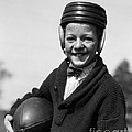 Boy In Old-fashioined Football Gear by H. Armstrong Roberts/ClassicStock