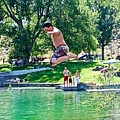 Boy Jumping Off The Board Into Dierkes Lake In Snake River Near Twin Falls-idaho   by Ruth Hager