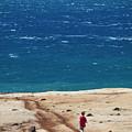 Boy Runs Toward Ocean by Stephen Simpson