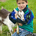 Boy With Goat by Inga Spence