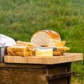 Bread With Butter On Cutting Board by Jacek Wojnarowski
