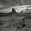Breaking Light At Monument Valley - Black And White by Brian Stamm