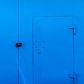 Bright Blue Locked Door And Padlock by John Williams