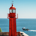 Bright Red Portuguese Lighthouse by Alexandre Rotenberg