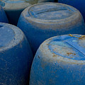 Brightly Colored Blue Barrels by Todd Gipstein