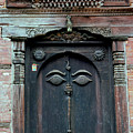Buddha's Eyes On Nepalese Wooden Door by Anna Lisa Yoder