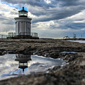 Bug Light Clouds And Reflection by Joe Faragalli