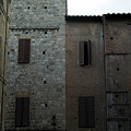 Buildings On A Side Street In Siena by Todd Gipstein