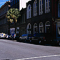 Buildings On Both Sides Of A Road by Panoramic Images