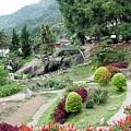 Burma Village Garden And Pond by John Johnson