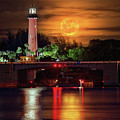 Burning Moon Rising Over Jupiter Lighthouse by Justin Kelefas