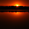 Burnt Orange Sunset On Water by Clayton Bruster