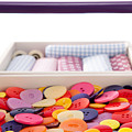 Buttons And Textile Fabrics In A Sewing Box by Wolfgang Steiner