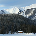 Cabin On Frozen Lake by Greg Hammond