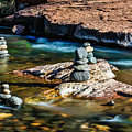 Cairns In The Creek by Dennis Swena