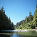 Calm Sandy River In Sandy, Oregon by Bradley Hebdon