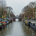 Canal In Amsterdam by Spade Photo