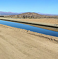 Canal Surrounded By Desert by Joe Lach