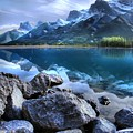 Canmore Reservoir Under A Setting Sun by Ken McMullen