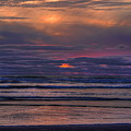 Cannon Beach Sunset by Dale Kauzlaric