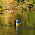 Canoe Paddling In Fall by Les Palenik