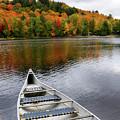 Canoe On A Lake by Oleksiy Maksymenko