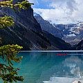 Canoe On Lake Louise by Larry Ricker