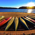 Canoes At Sunset by Kathy Kmonicek