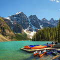 Canoes On A Jetty At  Moraine Lake In Banff National Park, Canada by Miroslav Liska