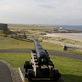 Canon Defends Bamburgh Castle by Carl Purcell