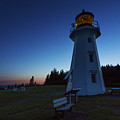 Cap Gaspe Lighthouse At Sunset by John Meader