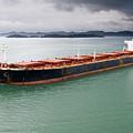 Cargo Ship Under Stormy Sky by John Trax