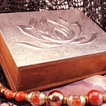 Carved Box In Aluminum. Silver Box And Red Necklace by Daniel Ghioldi