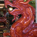 Carved Wood Dragon With Ball In Mouth by Sally Weigand