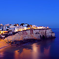 Carvoeiro In The Algarve Portugal At Night by Nisangha Ji