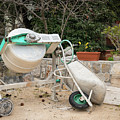 Cement Mixer And A Wheelbarrow In Croatia by Stefan Rotter