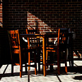Chairs And Shadows by Phil Penne