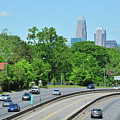 Charlotte Skyline From A Distance by Dennis Ludlow